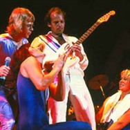 Björn, Frida and Agnetha surrounding guitarist Lasse Wellander during Does Your Mother Know.