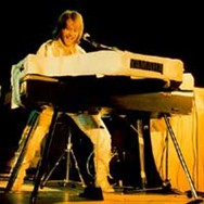 Benny on stage during the 1977 tour of Europe and Australia.