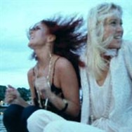 Frida and Agnetha aboard Benny's boat in the Summer Night City promo clip.