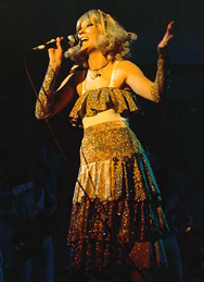 Agnetha on stage, performing The Girl With The Golden Hair during ABBA's 1977 tour.